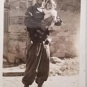 Who is This WWII American Soldier Liberating a Little Girl In France